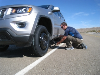 me exhaning the flat tire in Death valley